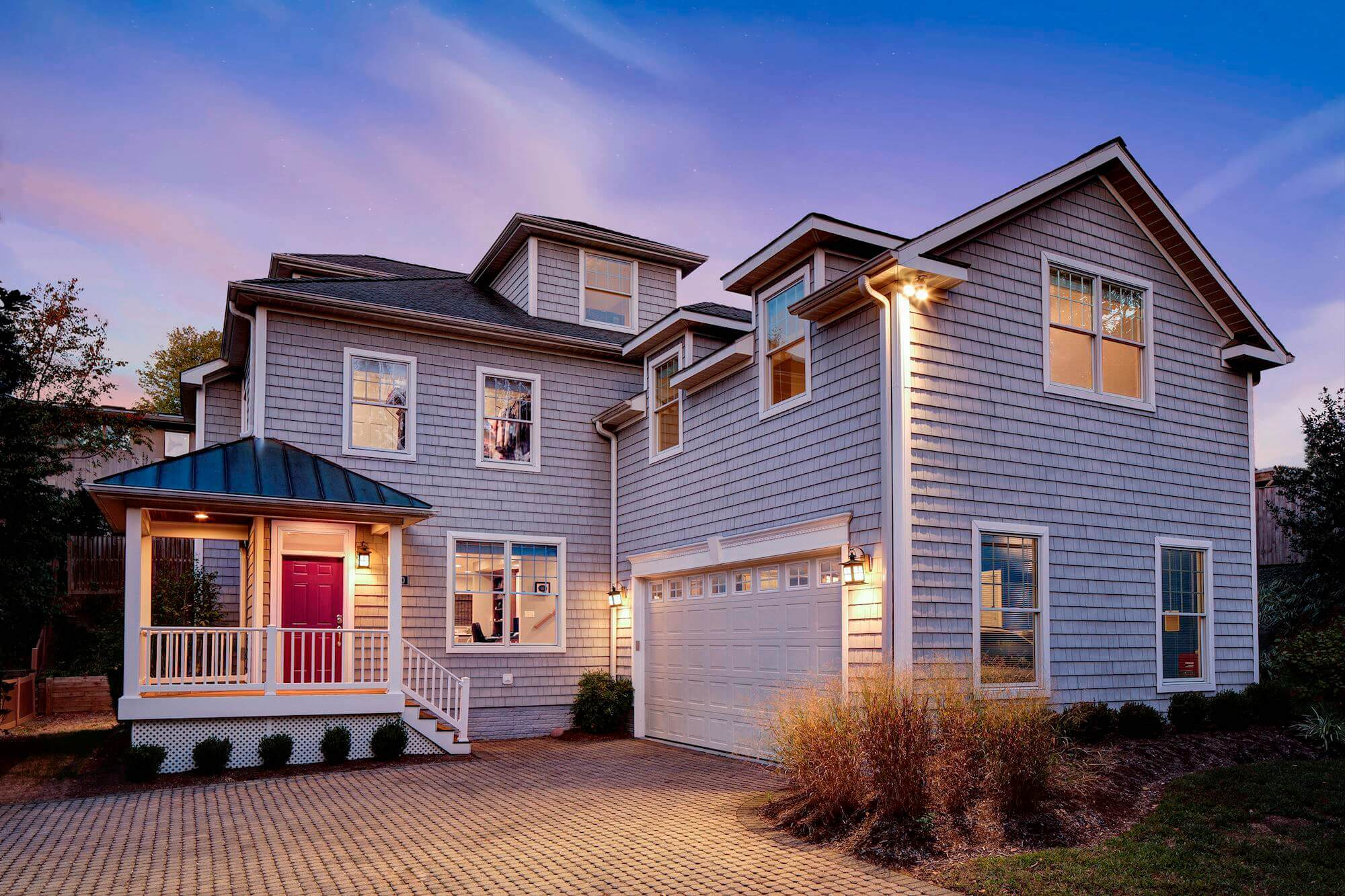 Two story single family home with a red door